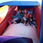 Photo of children on inflatible slide