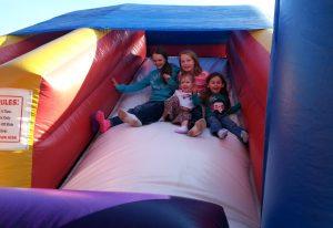 Photo of children on inflatible slide