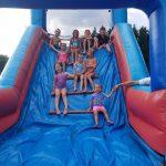 Photo of children sliding down inflatable slide