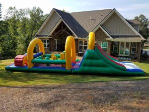 Photo of inlatable obstacle course in front yard