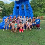 Photo of children posing in front of inflatable slide